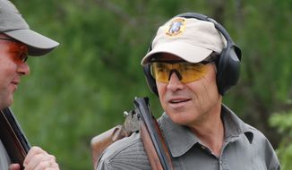 ** FILE ** Texas Gov. Rick Perry with a shotgun (Kelsey Orr, Texans for Rick Perry 2010)