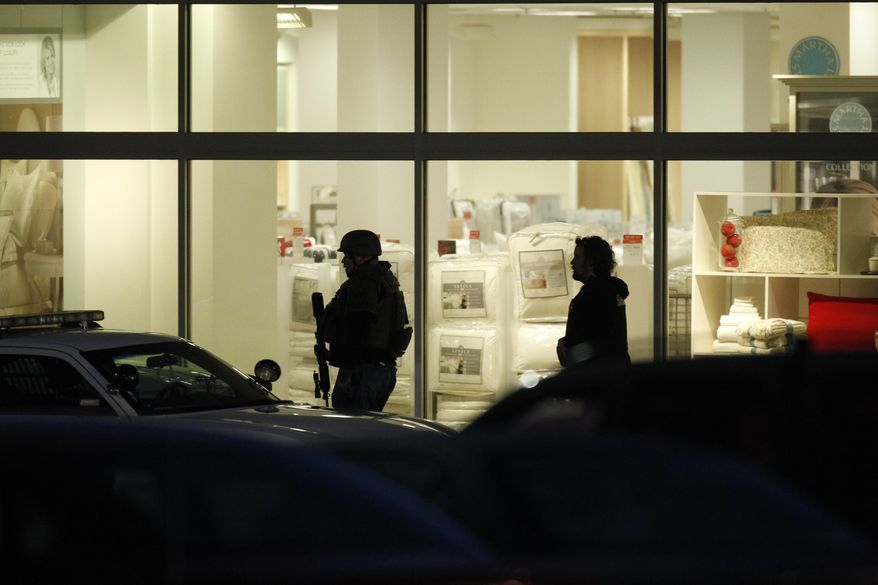 Law enforcement personnel work the scene of a shooting at the Clackamas Town Center in Portland, Ore. Tuesday, Dec. 11, 2012. A gunman is dead after opening fire in the Portland, Ore., area shopping mall Tuesday, killing two people and wounding another, sheriff's deputies said. (AP Photo/The Oregonian, Bruce Ely)