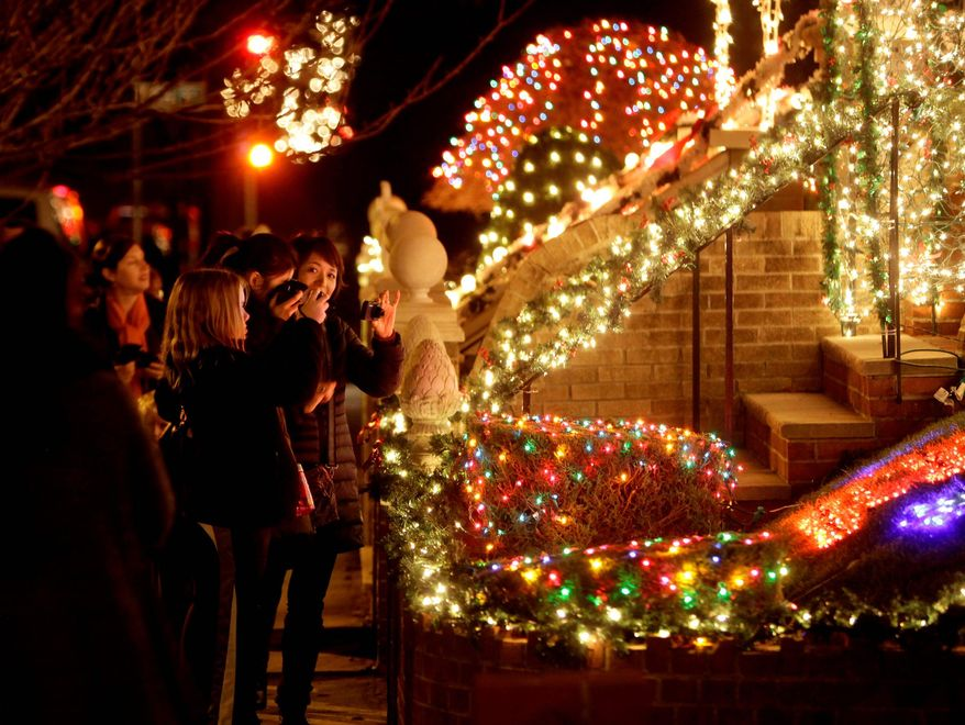 Spectators view an elaborately decorated home for the holidays in Brooklyn. The locals in the neighborhoods of Dyker Heights and Bay Ridge take pride in over-the-top displays. (Associated Press)