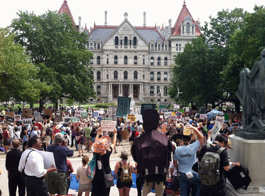 More than 1,000 protesters were involved in a march on the New York State Capitol in Albany in August demanding that Gov. Andrew Cuomo ban fracking in the state. While the governor still hasn't ruled, the state attorney general and six other East Coast states are suing for harsher air-quality rules on the oil and gas industry and its most effective drilling method. (Associated Press)