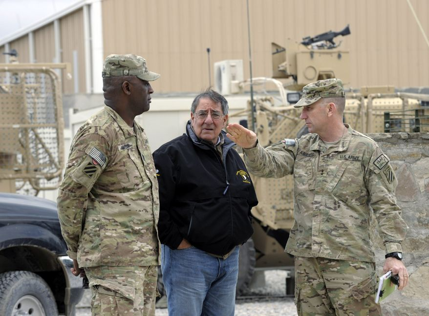 Defense Secretary Leon E. Panetta (center) talks with Army Maj. Gen. Robert Abrams (right) and Command Sgt. Maj. Edd Watson during a visit to Kandahar Airfield in Kandahar, Afghanistan, on Thursday, Dec. 13, 2012. (AP Photo/Susan Walsh, Pool)