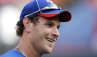 FILE - In this June 15, 2010 file photo, Texas Rangers' Josh Hamilton smiles smiles during batting practice before an interleague baseball game against the Florida Marlins in Miami. Rangers general manager Jon Daniels said Thursday, Dec. 13, 2012, that Hamilton has agreed to a contract with the Los Angeles Angels. (AP Photo/Lynne Sladky, File)
