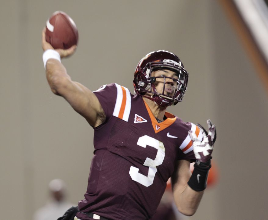 Virginia Tech quarterback Logan Thomas (3) tosses the ball during the first half of a NCAA college football game in Blacksburg, Va., Thursday, Nov. 8, 2012. (AP Photo/Steve Helber)