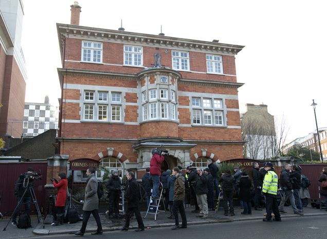 The media gather outside Westminster Coroner's Court in London, where the initial inquest into nurse Jacintha Saldanha's death was opened on Thursday, Dec. 13, 2012. (AP Photo/Alastair Grant)