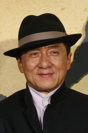"""Movie star Jackie Chan poses for photographers during the charity premiere of his new movie """"CZ12"""" in Hong Kong on Dec. 13, 2012. (Associated Press)"""