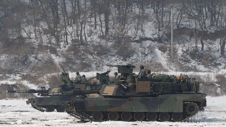 U.S. tanks move during a military exercise near the Demilitarized Zone between South and North Koreas, in Paju, South Korea, on Dec. 13, 2012. (Associated Press)