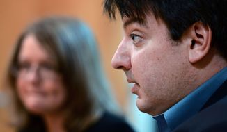 In this Nov. 21, 2012, photo, attorney, Mark Chalos, right, sits with Melanie Norwood, rear left, as they talk about the condition of Norwood's mother, Marjorie Norwood, in Nashville, Tenn. Marjorie Norwood, 59, became sick with fungal meningitis after getting steroid shots produced by the New England Compounding Center. (AP Photo/Mark Zaleski)