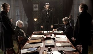 "Daniel Day-Lewis (center rear) stars as Abraham Lincoln in the Steven Spielberg film ""Lincoln."" (AP Photo/DreamWorks, Twentieth Century Fox, David James)"