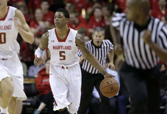 Maryland guard Nick Faust drives against South Carolina State in the second half of an NCAA college basketball game in College Park, Md., Saturday, Dec. 8, 2012. (AP Photo/Patrick Semansky)