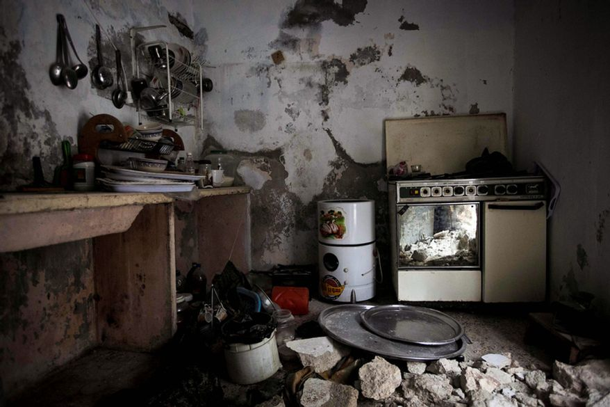 A kitchen damaged by heavy clashes between Free Syrian Army fighters and government forces in Aleppo, Syria, is seen here on Dec. 10, 2012. (Associated Press)