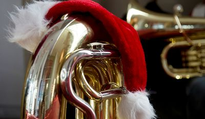 "A Santa Claus hat rests on ""Estelle"" the tuba, which belongs to Larry Wile of Silver, Spring, Md. He was one of hundreds of tuba players who came to the Kennedy Center in Washington, D.C. on Thursday, Dec. 13, 2012 to participate in Tuba Christmas, a concert that originated in 1974 as a tribute to the late artist/teacher William J. Bell, who was born on Christmas Day in 1902.  (Barbara L. Salisbury/The Washington Times)"