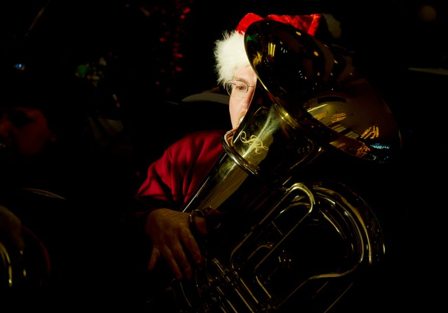 A tuba player rehearses at the Kennedy Center in Washington, D.C. on Thursday, Dec. 13, 2012 for Tuba Christmas. (Barbara L. Salisbury/The Washington Times)