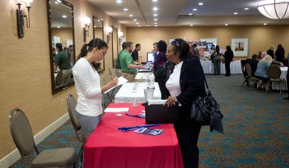 A job hunter fills out an employment application at the Fort Lauderdale Career Fair in Dania Beach, Fla., on Friday, Nov. 30, 2012. The U.S. economy added a solid 146,000 jobs in November, and the unemployment rate fell to 7.7 percent, the lowest since December 2008, the Labor Department announced. (AP Photo/J Pat Carter)