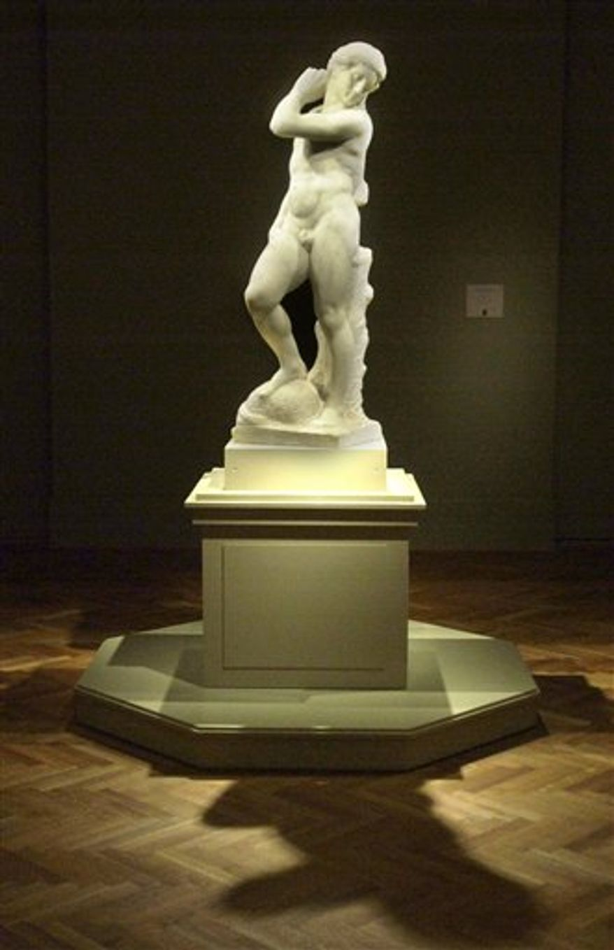 """** FILE ** In this Nov. 6, 2002, file photo, Michelangelo's """"David-Apollo"""" is bathed in light at the Art Institute of Chicago. The sculpture goes on view Thursday, Dec. 13, 2012, at the National Gallery of Art in Washington. The sculpture, from the year 1530, is on loan from the Museo Nazionale del Bargello in Florence, and was last shown in the U.S. capital in 1949 when it drew nearly 800,000 visitors. It was also a centerpiece for those who attended President Harry Truman's inaugural reception at the gallery. (AP Photo/Brandi Jade Thomas, File)"""