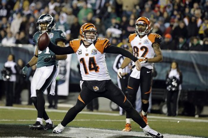 Cincinnati Bengals' Andy Dalton spikes the ball after scoring a touchdown in the second half of an NFL game against the Philadelphia Eagles, Thursday, Dec. 13, 2012, in Philadelphia. (AP Photo/Mel Evans)