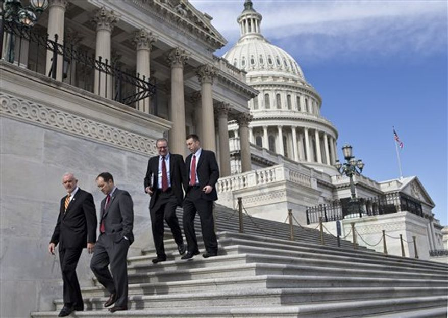 ** FILE ** Congressmen walk down the steps of the House of Representatives at the Capitol as rank and file members adjourned for several days, in Washington, Wednesday, Dec. 5, 2012. House Speaker John Boehner, R-Ohio, and House Majority Leader Eric Cantor, R-Va., have advised members to be ready to work on the fiscal cliff negotiations during the Christmas holiday period. (AP Photo/J. Scott Applewhite)