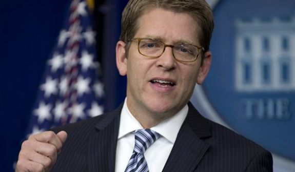 White House press secretary Jay Carney gestures as he speaks during his daily news briefing at the White House in Washington, Thursday, Dec. 13, 2012. (AP Photo/Carolyn Kaster)