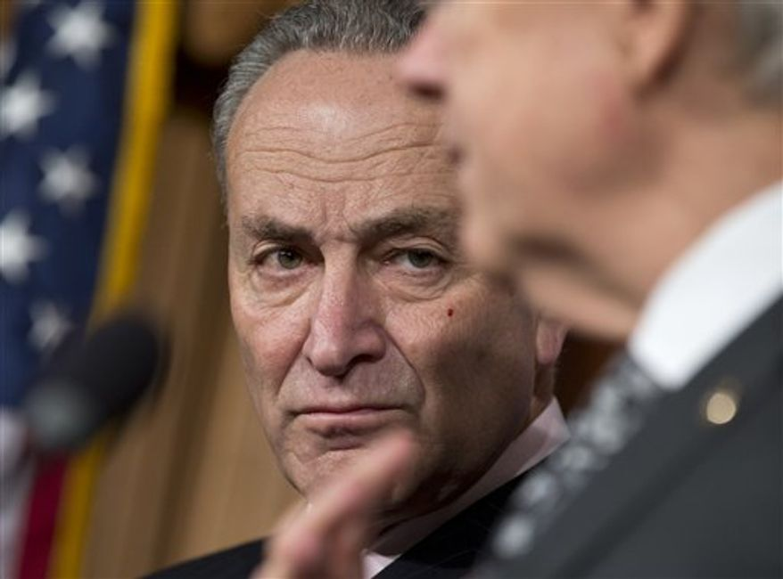 Sen. Charles Schumer, D-N.Y., listens at left as Senate Majority Leader Harry Reid of Nev., right, speaks during a news conference on Capitol Hill in Washington, Thursday, Dec. 13, 2012, to discuss the stalled fiscal cliff negotiations and other unfinished business in the Senate.  (AP Photo/J. Scott Applewhite)