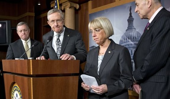 Senate Majority Leader Harry Reid of Nev., second from left, accompanied by fellow Senate Democratic leaders, pauses during a news conference on Capitol Hill in Washington, Thursday, Dec. 13, 2012, to discuss the stalled fiscal cliff negotiations and other unfinished business in the Senate. From left are, Senate Majority Whip Richard Durbin of Ill., Reid, Sen. Patty Murray, D-Wash., and Sen. Charles Schumer, D-N.Y. (AP Photo/J. Scott Applewhite)