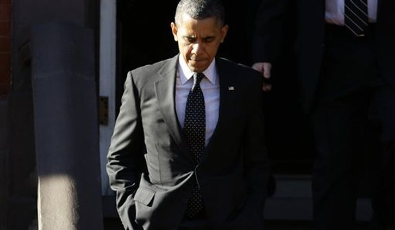 President Barack Obama walks out of Blair House in Washington, Thursday, Dec. 13, 2012, before crossing Pennsylvania Avenue and returning to the White House after attending a holiday party for the National Security Council. (AP Photo/Charles Dharapak)