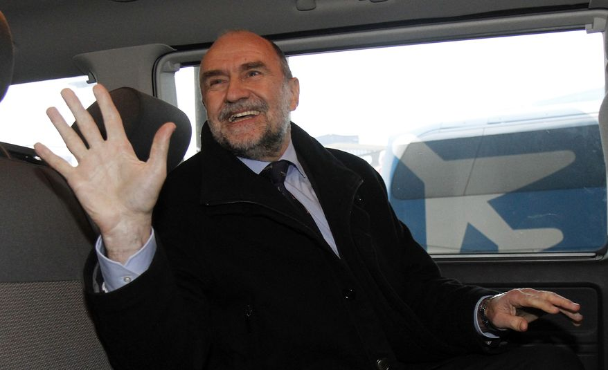 Herman Nackaerts, deputy director general and head of the Department of Safeguards of the International Atomic Energy Agency (IAEA), waves as he arrives from Iran at Schwechat Airport in Vienna, Austria, on Dec. 14, 2012. (Associated Press)