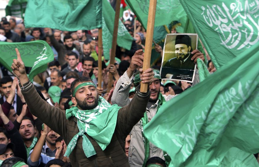 **FILE** Palestinian supporters of Hamas wave flags during a rally in the West Bank city of Tulkarem on Dec. 14, 2012, to celebrate the 25th anniversary of the militant group. (Associated Press)