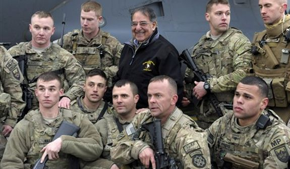 U.S. Defense Secretary Leon Panetta poses for a photo with troops at Kabul International Airport in Kabul, Afghanistan, Friday, Dec. 14, 2012, before boarding his plane and heading back to Washington. Panetta spent three days in Afghanistan meeting with troops, commanders and Afghani leaders. (AP Photo/Susan Walsh, Pool)