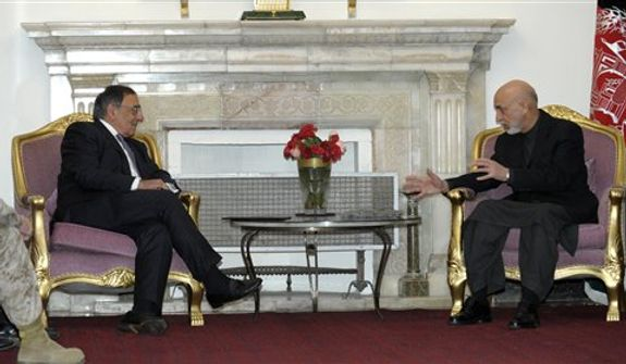 U.S. Defense Secretary Leon Panetta, left, listens as Afghanistan President Hamid Karzai, right, speaks during their meeting at the Presidential Palace in Kabul, Afghanistan, Thursday, Dec. 13, 2012. (AP Photo/Susan Walsh, Pool)
