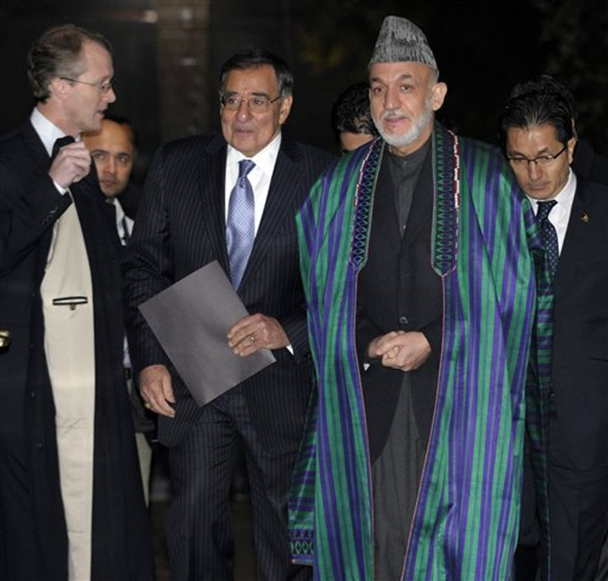 U.S. Defense Secretary Leon Panetta and Afghanistan President Hamid Karzai arrive for their joint news conference at the Presidential Palace in Kabul, Afghanistan, Thursday, Dec. 13, 2012. (AP Photo/Susan Walsh, Pool)