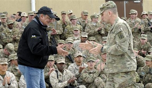 U.S. Defense Secretary Leon Panetta, left, goes to shake hands with Army Maj. Gen. Robert Abrams, right, after Abrams introduced Panetta to the troops during a visit to Kandahar Airfield in Kandahar, Afghanistan, Thursday, Dec. 13, 2012.  (AP Photo/Susan Walsh, Pool)