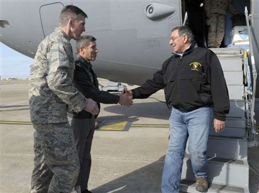 Defense Secretary Leon Panetta, right, walks off of his plane and  shakes hands with 10th Tanker Base Commander Brig. Gen Serdar Gulbas, center, Col. Christopher E. Craige, at left, Commander of the 39th Air Base Wing at Incirlik Air Base, Turkey, Friday, Dec. 14, 2012. Panetta stopped to visit troops in Turkey before heading home after spending three days in Afghanistan. (AP Photo/Susan Walsh, Pool)