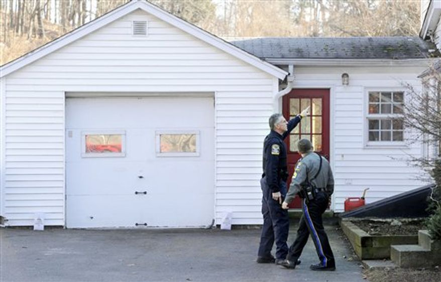 Law enforcement canvass an area nearby a school shooting at the Sandy Hook Elementary School in Newtown, Conn., about 60 miles (96 kilometers) northeast of New York City, Friday, Dec. 14, 2012. An official with knowledge of Friday's shooting said 27 people were dead, including 18 children. (AP Photo/Jessica Hill)