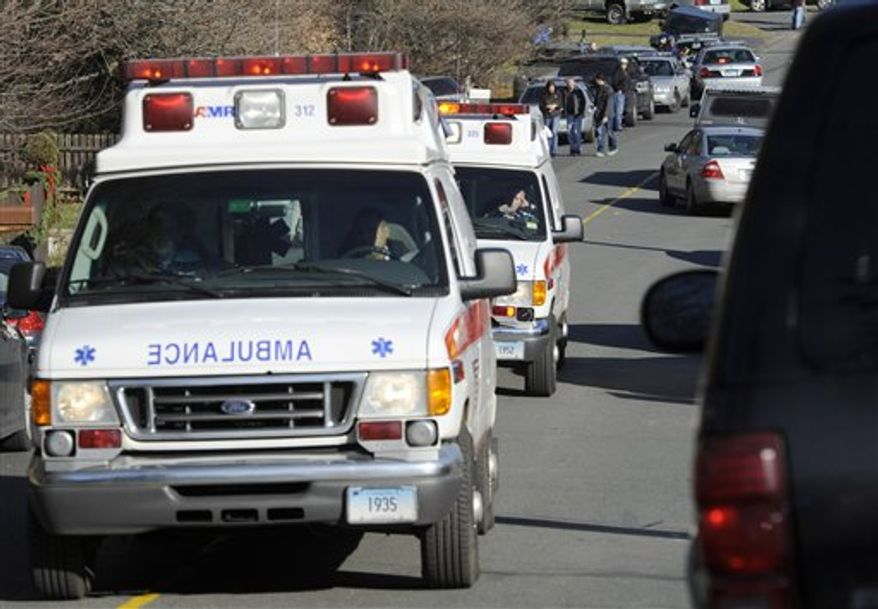 Ambulances leave an area near the scene of a shooting at the Sandy Hook Elementary School in Newtown, Conn., about 60 miles (96 kilometers) northeast of New York City, Friday, Dec. 14, 2012. An official with knowledge of Friday's shooting said 27 people were dead, including 18 children.  (AP Photo/Jessica Hill)