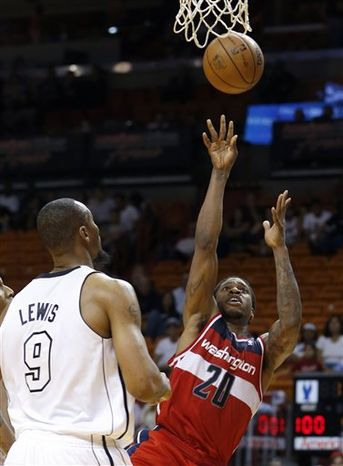 Washington Wizards' Cartier Martin (20) as Miami Heat's Rashard Lewis (9) looks on during the second half of an NBA basketball game in Miami, Saturday, Dec 15, 2012. The Heat won 102-72. (AP Photo/Alan Diaz)