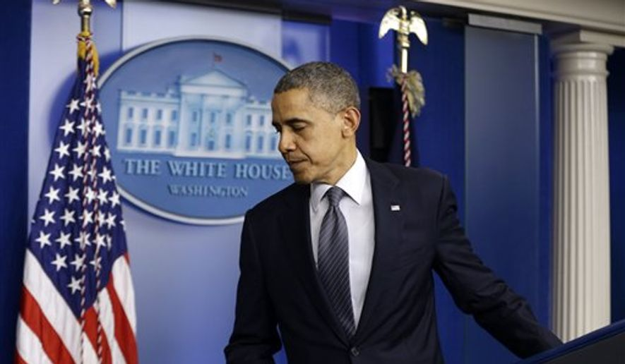 President Barack Obama leaves the podium after speaking about the school shooting in Newtown, Conn., Friday, Dec. 14, 2012, in the briefing room of the White House in Washington. (AP Photo/Charles Dharapak)