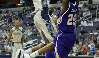 Georgetown Hoyas forward Otto Porter (22) shoots to score overst Western Carolina Catamounts guard James Sinclair (25) during the first half of an NCAA college basketball game at the Verizon Center in Washington, on Saturday, Dec. 15, 2012. (AP Photo/Jacquelyn Martin)