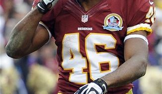 Washington Redskins running back Alfred Morris acknowledges the crowd after scoring a touchdown during the first half of an NFL football game against the Baltimore Ravens in Landover, Md., Sunday, Dec. 9, 2012. (AP Photo/Nick Wass)