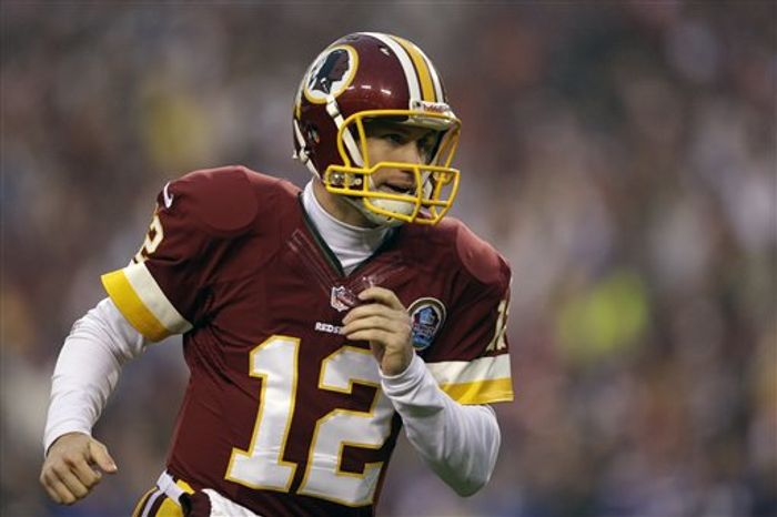 Washington Redskins quarterback Kirk Cousins runs on to the field during the second half of an NFL football game against the Baltimore Ravens in Landover, Md., Sunday, Dec. 9, 2012. (AP Photo/Patrick Semansky)