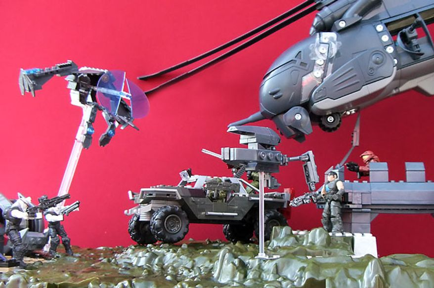 Builders can create a full scale war mixing Meccano's King Raven copter from the Gears of War collection and Mega Bloks line of Halo vehicles and sets. (Photograph by Joseph Szadkowski)