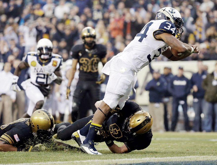 Navy fullback Noah Copeland, shown on a 12-yard touchdown run against Army on Dec. 8 then celebrating the score (below), plays a battering style despite his 5-foot-10, 205-pound frame. He has 694 yards entering the Fight Hunger Bowl against Arizona State on Dec. 29 in San Francisco. (Associated Press)