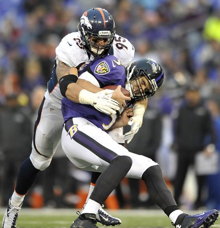 Baltimore Ravens quarterback Joe Flacco is sacked by Denver Broncos defensive end Derek Wolfe during the second half of an NFL football game in Baltimore, Sunday, Dec. 16, 2012. The Broncos defeated the Ravens 34-17. (AP Photo/Gail Burton)