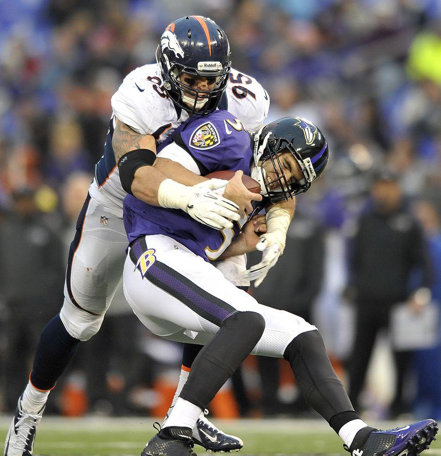 Baltimore Ravens quarterback Joe Flacco is sacked by Denver Broncos defensive end Derek Wolfe during the second half of an NFL football game in Baltimore, Sunday, Dec. 16, 2012. The Broncos defeated the Ravens 34-17. (AP Photo/Gail Burton)
