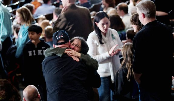Residents greet each other before the start of an interfaith vigil for the victims of the Sandy Hook Elementary School shooting on Sunday, Dec. 16, 2012 at Newtown High School in Newtown, Conn.   (AP Photo/Evan Vucci)