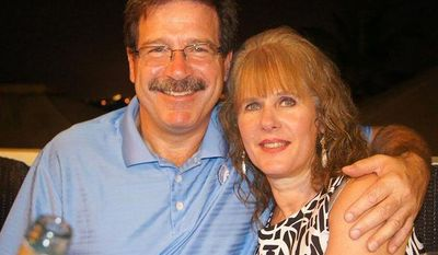 School psychologist Mary Sherlach, who was killed on Friday, Dec. 14, 2012, when a gunman opened fire at Sandy Hook Elementary School in Newtown, Conn., is pictured with her husband, Mark. (AP Photo/Courtesy of Mark Sherlach)