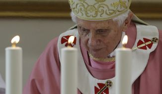 Pope Benedict XVI celebrates Mass in St. Patrick Church in Rome on Sunday, Dec. 16, 2012. (AP Photo/Gregorio Borgia)