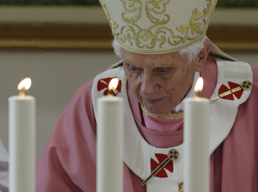Pope Benedict XVI celebrates Mass in St. Patrick Church in Rome on Sunday, Dec. 16, 2012. (AP Photo/Gregorio Borgia)