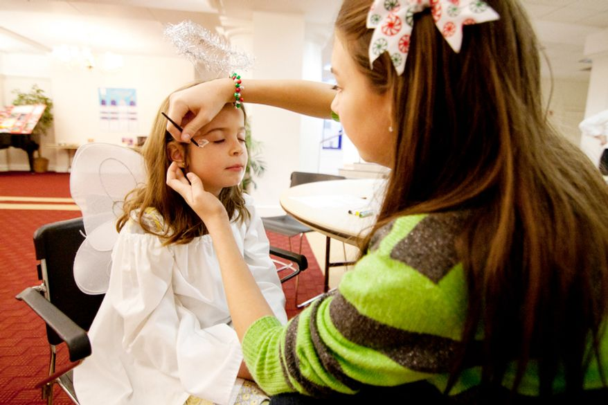 Children part of the Christ Church Sunday school and youth group get dressed up with face paint before their Christmas Pageant in Alexandria, Va. (Craig Bisacre/The Washington Times)