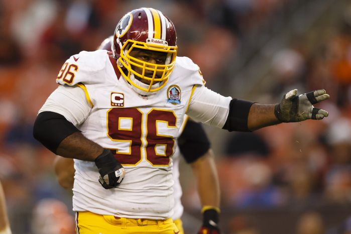 Washington Redskins nose tackle Barry Cofield (96) celebrates his sack of Cleveland Browns quarterback Brandon Weeden, not pictured, in the fourth quarter of an NFL football game in Cleveland, Sunday, Dec. 16, 2012. (AP Photo/Rick Osentoski)