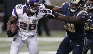 Minnesota Vikings running back Adrian Peterson, left, runs past St. Louis Rams outside linebacker Jo-Lonn Dunbar on his way to a 52-yard touchdown run during the fourth quarter of an NFL football game Sunday, Dec. 16, 2012, in St. Louis. (AP Photo/Tom Gannam)