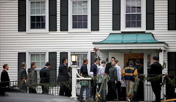 Mourners arrive for the funeral service of Sandy Hook Elementary School shooting victim, six-year-old Jack Pinto, Monday, Dec. 17, 2012, in Newtown, Conn. A gunman walked into Sandy Hook Elementary School in Newtown Friday and opened fire, killing 26 people, including 20 children.  (AP Photo/David Goldman)